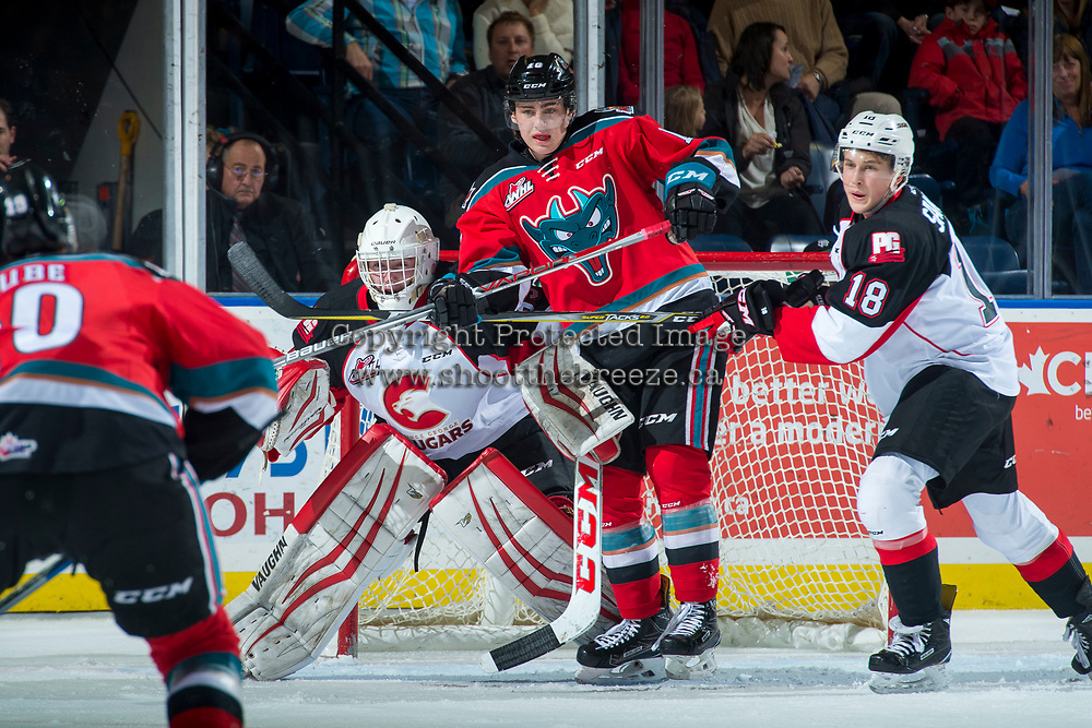 KELOWNA, CANADA - OCTOBER 28: Kole Lind #16 of the Kelowna Rockets looks for the pass in front of the net of Taylor Gauthier #35 of the Prince George Cougars during first period on October 28, 2017 at Prospera Place in Kelowna, British Columbia, Canada.  (Photo by Marissa Baecker/Shoot the Breeze)  *** Local Caption ***