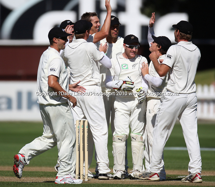 NZ's Brent Arnel celebrates his first test wicket of Phil Hughes, taken in his first over bowling for NZ.<br /> 1st cricket test match - New Zealand Black Caps v Australia, day one at the Basin Reserve, Wellington.Friday, 19 March 2010. Photo: Dave Lintott/PHOTOSPORT