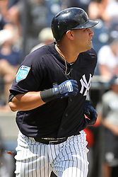 March 18, 2018 - Tampa, FL, U.S. - TAMPA, FL - MAR 18: Gary Sanchez (24) of the Yankees watches his hit fly over the fence for a home run during the game between the Miami Marlins and the New York Yankees on March 18, 2018, at George M. Steinbrenner Field in Tampa, FL. (Photo by Cliff Welch/Icon Sportswire) (Credit Image: © Cliff Welch/Icon SMI via ZUMA Press)