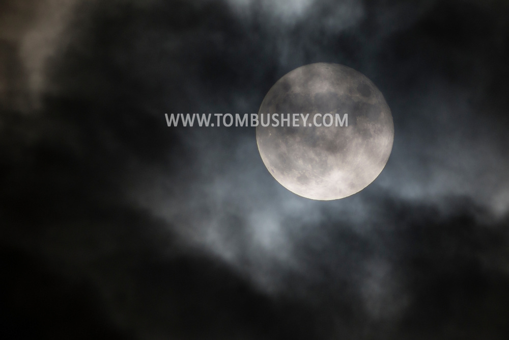 Middletown, New York - The full moon of October, known as the Hunter's Moon, shines through the clouds on Oct.27, 2015.