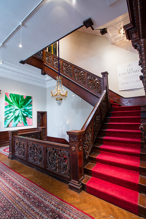 The ornately carved staircase in The Ukrainian Institute.