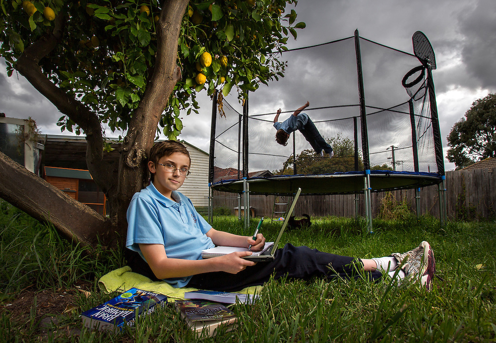 Child author Max Sillitoe (11 years) working on his second book  to be self published by www.kidpub.com. Brother Jack (9 years) wants Max to stop writing &amp; hop on the trampoline with him. Pic By Craig Sillitoe Photography, 12/10/2012 melbourne photographers, commercial photographers, industrial photographers, corporate photographer, architectural photographers, This photograph can be used for non commercial uses with attribution. Credit: Craig Sillitoe Photography / http://www.csillitoe.com<br />