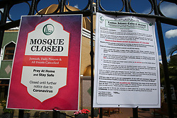 © Licensed to London News Pictures. 13/06/2020. London, UK. 'MOSQUE CLOSED' sign and a notice that the mosque will not open on Monday on the gates of Wightman Road Mosque. <br /> Wightman Road Mosque also known as London Islamic Cultural Society and Mosque in north London will not open on Monday 15 June. Last week, the government announced that churches, mosques, temples and other places of worship in England can open for private prayer from 15 June. Mosques provide congregational worship rather than private prayer, and as there is significant uncertainty and concern around how the new regulations can be implemented, mosques will not reopen on Monday.  Photo credit: Dinendra Haria/LNP