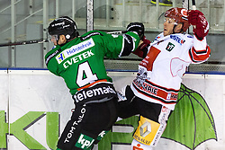 28.09.2014, Hala Tivoli, Ljubljana, SLO, EBEL, HDD Telemach Olimpija Ljubljana vs HC TWK Innsbruck, 6. Runde, in picture Igro Cvetek (HDD Telemach Olimpija, #29) with big hit against Jeff Ulmer (HC TWK Innsbruck, #4) during the Erste Bank Icehockey League 6. Round between HDD Telemach Olimpija Ljubljana and HC TWK Innsbruck at the Hala Tivoli, Ljubljana, Slovenia on 2014/09/28. Photo by Matic Klansek Velej / Sportida