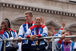 © Licensed to London News Pictures. 10/09/2012. LONDON, UK. Olympic gold medal winning heptathlete Jessica Ennis (C) is seen smiling from a float during a parade held for all of the British athletes who competed in the London 2012 Olympic and Paralympic Games. Photo credit: Matt Cetti-Roberts/LNP