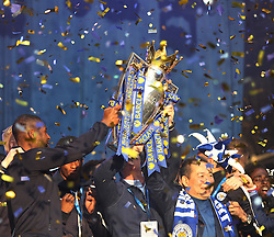 Leicester City players and chairman Vichai Srivaddhanaprabha (C) hold up the trophy to fans at Victoria park during the victory celebrations  - Mandatory by-line: Jack Phillips/JMP - 16/05/2016 - FOOTBALL - Leicester City FC, Sky Bet Premier League Winners 2016 - Leicester City Victory Parade