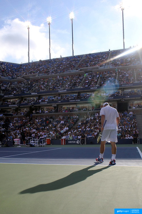 Andy Roddick, USA, heads back to his seat after losing the third set to Juan Martin Del Potro, Argentina, during the US Open Tennis Tournament, Flushing, New York. USA. 5th September 2012. Photo Tim Clayton