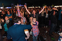 © Licensed to London News Pictures. 04/08/2012. London, UK.   Crowd celebrations at BT London Live, Hyde Park, as Mo Farah wins Gold medal in the 10,000m for Team GB.  He is the first British Man to have done so.  Photo credit : Richard Isaac/LNP
