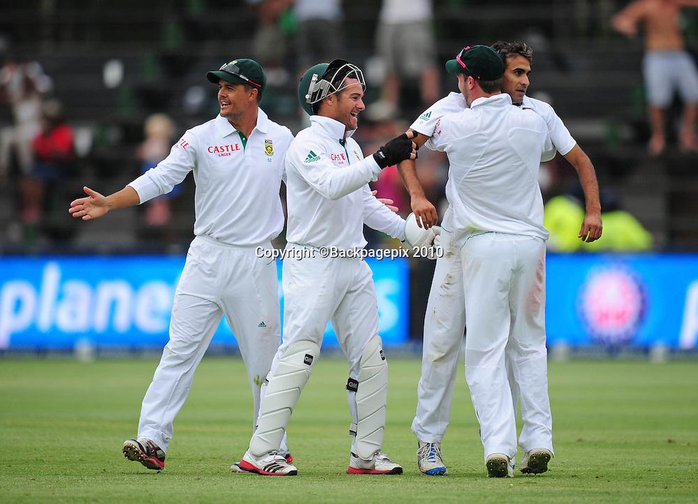 Imran Tahir of South Africa celebrates taking the wicket of Australia's Usman Khawaja , Cricket - 2011 Sunfoil Test Series - South Africa v Australia - Day 4 - Wanderers Stadium, Johannesburg. 20 November 2011<br /> &copy;Chris Ricco/Backpagepix