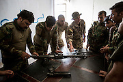 "KURDISTAN, NORTHERN IRAQ, Dokuk.<br /> Qalubna Ma'Kum Feature:<br /> Qalubna Ma'kum (meaning ""Our hearts are With You"") are a group of foreign volunteer fighters who have joined up with the Peshmerga in Kurdistan to help with the battle against Daesh, also known as ISIS. <br /> <br /> Pictured: Volunteers help teach peshmerga soldiers how to clean and maintain a weapon."