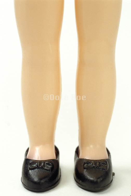 doll legs and black shoes