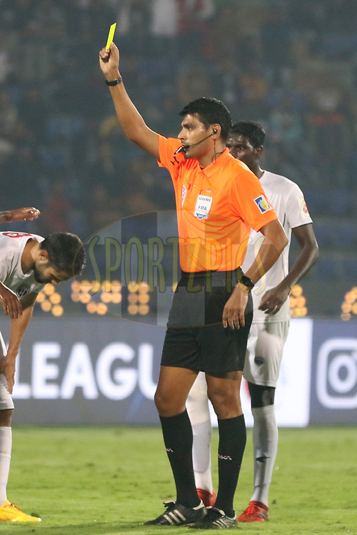Referee showing yellow card during match 19 of the Hero Indian Super League between NorthEast United FC and Bengaluru FC held at the Indira Gandhi Athletic Stadium, Guwahati India on the 8th December 2017<br /> <br /> Photo by: Saikat Das  / ISL / SPORTZPICS