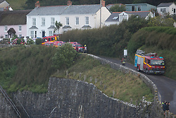 © Licensed to London News Pictures. 18/07/2017. Coverack, UK.  Cornwall Fire and Rescue vehicles parked in Cornish village of Coverack this afternoon after heavy rainfall.  Photo credit: Ashley Hugo/LNP
