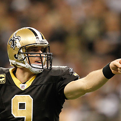 December 4, 2011; New Orleans, LA, USA; New Orleans Saints quarterback Drew Brees (9) against the Detroit Lions during the second quarter of a game at the Mercedes-Benz Superdome. The Saints defeated the Lions 31-17. Mandatory Credit: Derick E. Hingle-US PRESSWIRE