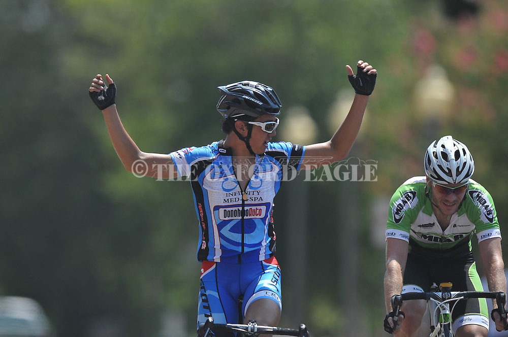 Justin Bynum (blue) wins the Men's Cat 3 bike race of the Oxford Square Criterium in Oxford, Miss. on Sunday, August 7, 2011. The race is part of the Oxford Endurance Weekend.