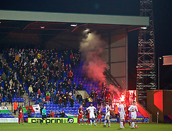 BIRKENHEAD, ENGLAND - Saturday, January 3, 2015: Swansea City supporters set off a red flare as they celebrate their side's 6-2 victory over Tranmere Rovers during the FA Cup 3rd Round match at Prenton Park. (Pic by David Rawcliffe/Propaganda)