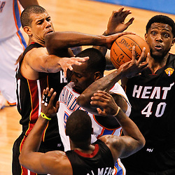 Jun 14, 2012; Oklahoma City, OK, USA; Miami Heat point guard Mario Chalmers (15), power forward Udonis Haslem (40) and small forward Shane Battier (31) surround Oklahoma City Thunder center Kendrick Perkins (5) during the third quarter of game two in the 2012 NBA Finals at Chesapeake Energy Arena. Mandatory Credit: Derick E. Hingle-USA TODAY SPORTS