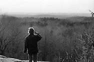 Woman looks out over a ravine in Kendall Park in Kent, Ohio.