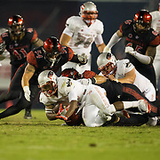 08 October 2016: The San Diego State Aztecs football team open's up the mountain west conference season at home against the University of Nevada Las Vegas Rebels. San Diego State linebackers Calvin Munson (54) and Ronley Lakalaka (39) combine for tackle in the third quarter. The Aztecs beat the Rebels 26-7 to improve to 4-1 and 1-0 in conference play. www.sdsuaztecphotos.com