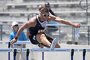 Jul 26, 2019; Des Moines, IA, USA; Kurt Brondyke runs a wind-aided 14.64 in the decathlon 110m hurdles  during the USATF Championships at Drake Stadium.