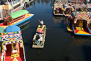 Xochimilco is one of the sixteen delegaciones within Mexican Federal District. It is located south from Mexico City. The Xochimilco canals, all that's left of the extensive chinampas, are now a popular tourist attraction whose shores are crowded with houses and docks. The canals are particularly popular on the weekends and during public holidays, when many Mexican families and tourists rent boats complete with musicians and food. Feb. 24, 2008. (ivan gonzalez).