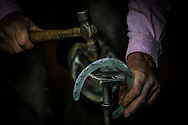 LOUISVILLE, KY - MAY 03: A farrier works on a horse shoe during Derby week at Churchill Downs on May 03, 2017 in Louisville, Kentucky. (Photo by Alex Evers/Eclipse Sportswire/Getty Images)