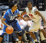 """Kentucky's Ryan Harrow (12) works against Mississippi's Jarvis Summers (32) at the C.M. """"Tad"""" Smith Coliseum on Tuesday, January 29, 2013. Kentucky won 87-74. (AP Photo/Oxford Eagle, Bruce Newman).."""