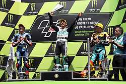 June 17, 2018 - Montmelo, Catalunya, Spain - Enea BASTIANINI of Italy and Leopard Racing celebrates victory on the podium with Marco BZZECCHI of Italy and redox PruestelGP (L) and Gabriel RODRIGO of Argentina and RBA BOE Skull Rider (R) during Gran Premi Monster Energy de Catalunya (Grand Prix of Catalunya), Moto3 race, on June 17, 2018 at the Catalunya racetrack in Montmelo, near Barcelona, Spain (Credit Image: © Manuel Blondeau via ZUMA Wire)