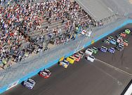Nov. 12 2011; Avondale, AZ, USA; NASCAR Nationwide Series driver Aric Almirola (88) leads Clint Bowyer (33)  and the pack during the Wypall 200 at Phoenix International Raceway. Mandatory Credit: Jennifer Stewart-US PRESSWIRE