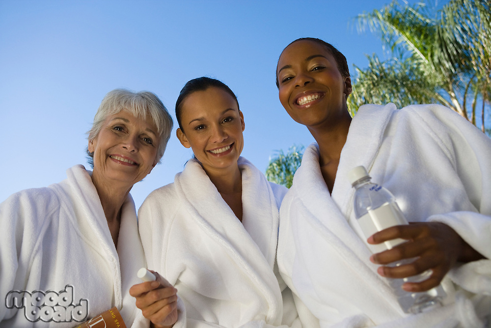 Portrait of three women in bathrobes at health spa