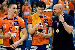 Dejan Vincic, Vid Jakopin and coach Glenn Hoag with a champaign after the final match of Slovenian National Volleyball Championships between ACH Volley Bled and Salonit Anhovo, on April 24, 2010, in Radovljica, Slovenia. ACH Volley defeated Salonit 3rd time in 3 Rounds and became Slovenian National Champion.  (Photo by Vid Ponikvar / Sportida)