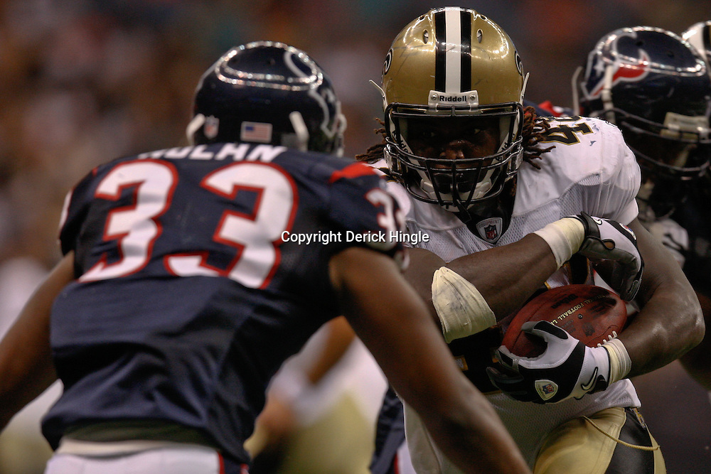 August 21, 2010; New Orleans, LA, USA; New Orleans Saints running back Chris Ivory (48) runs towards Houston Texans safety Troy Nolan (33) during the second half of a 38-20 win by the New Orleans Saints over the Houston Texans during a preseason game at the Louisiana Superdome. Mandatory Credit: Derick E. Hingle