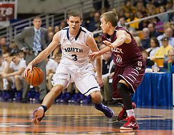 Parkersburg South guard Cody Monroe (3) makes a move around Woodrow Wilson guard Corey Acord (10) during a semi-final game at the Charleston Civic Center.