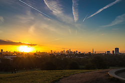 Primrose Hill, London, October 4th 2016. Dawn, seen from Primrose Hill, breaks across London, throwing the city's skyline into silhouette.