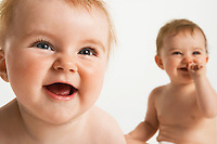 Two baby girls laughing