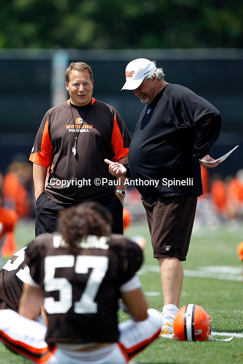 Cleveland Browns Head Coach Eric Mangini and Defensive Coordinator Rob Ryan chat with a player during NFL football training camp at the Cleveland Browns Training Complex on Monday, August 9, 2010 in Berea, Ohio. (©Paul Anthony Spinelli)