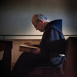 Lisa Johnston | lisajohnston@archstl.org A friar read in a pew in the Basilica of St. Franics. The Papal Basilica of St. Francis of Assisi is the mother church of the Order of Friars Minor (Franciscan Order).