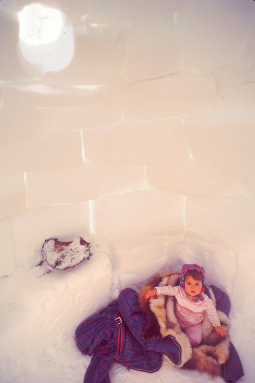 Alaska. Barrow. Igloo with child.