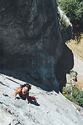Attractive female climber climbing a vertical limestone wall Mamut climbing athlete Bobbi Bensman enjoying a climbing trip at Roca Verde, Asturias, Spain