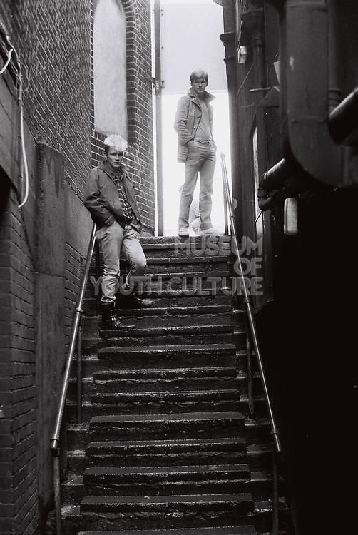 Teenage boys posing on steps, London, UK, 1983