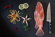 Ingredients to prepare fettuccine with scorpionfish, traditional italian recipe: fresh fettuccine pasta, red scorpionfish,garlic,parsley,chili pepper.