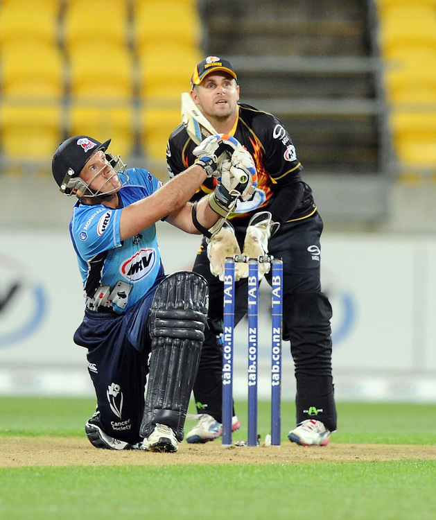 Auckland Aces Gareth Hopkins skies the ball in front of Wellington Firebirds Michael Papps to be caught by Michael Pollard in the HRV T20 cricket match at Westpac Stadium, Wellington, New Zealand, Saturday, November 23, 2013. Credit:SNPA / Ross Setford