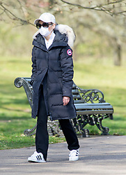 ©Licensed to London News Pictures 04/04/2020  <br /> Greenwich, UK.  A masked walker. People get out of the house from Coronavirus lockdown to exercise and enjoy the mini heatwave weather in Greenwich park,Greenwich, London. Photo credit:Grant Falvey/LNP