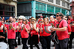 Members of Samba Galez participating in the Cardiff Pride parade. 2014