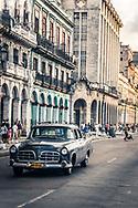 A Vintage 1950s car driving along the Malecon, Havana Cuba