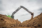 Volvo EC250E crawler excavator modified to work flood protection in the dutch Cortenoever. Photo: Erik Luntang