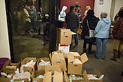 Beneficiaries wait in line to receive their donated food and clothing during a Milpitas Food Pantry event at Lifegate Church in Milpitas, California, on November 25, 2013. (Stan Olszewski/SOSKIphoto)
