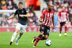 Nathan Redmond of Southampton is marked by Johann Gudmundsson of Burnley - Mandatory by-line: Ryan Hiscott/JMP - 12/08/2018 - FOOTBALL - St Mary's Stadium - Southampton, England - Southampton v Burnley - Premier League