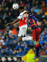 Arsenal's Danny Welbeck wins a header against Sergio Busquets of Barcelona - Mandatory byline: Matt McNulty/JMP - 16/03/2016 - FOOTBALL - Nou Camp - Barcelona,  - FC Barcelona v Arsenal - Champions League - Round of 16