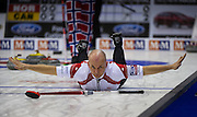 Canada's Jon Mead jokingly puts his arms out after he slipped on the ice and fell during play against Norway at the World Men's Curling Championships in Regina, Sask. (2011)